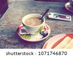 a cup of hot coffee placed on... | Shutterstock . vector #1071746870