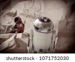 Small photo of APR 17 2018: Recreation of a scene from Star Wars A New Hope; Jawa scavengers of the desert planet Tattooine capture astromech droid R2D2 - Hasbro Black Series action figures
