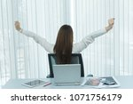 asian officer woman stretching... | Shutterstock . vector #1071756179