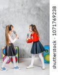 two little girls sing and dance.... | Shutterstock . vector #1071769238