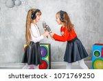 two little girl friends sing... | Shutterstock . vector #1071769250