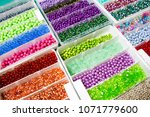 lots of colourful beads | Shutterstock . vector #1071779600