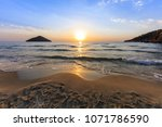 paradise beach at sunrise.... | Shutterstock . vector #1071786590