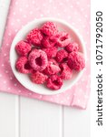 freeze dried raspberries in... | Shutterstock . vector #1071792050