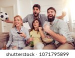 friends watching football game... | Shutterstock . vector #1071795899