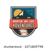 modern shield forest camp badge.... | Shutterstock .eps vector #1071809798