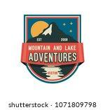 modern shield forest camp badge.... | Shutterstock .eps vector #1071809798
