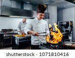 shot of two young chefs in the... | Shutterstock . vector #1071810416
