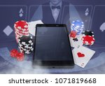phone with poker casino chips... | Shutterstock . vector #1071819668