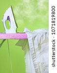 Small photo of Steam iron and ironing board