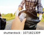 young volunteers with garbage... | Shutterstock . vector #1071821309