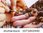 indian bridal woman making a... | Shutterstock . vector #1071843440
