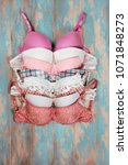 set of different bras on wooden ... | Shutterstock . vector #1071848273