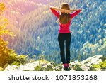 silhouette of a young happy... | Shutterstock . vector #1071853268