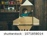 kid sit in cardboard hand made... | Shutterstock . vector #1071858014