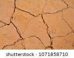 soil drought cracked texture...   Shutterstock . vector #1071858710