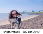 a happy woman is traveling in... | Shutterstock . vector #1071859040