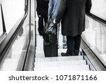 man standing on escalator or... | Shutterstock . vector #1071871166