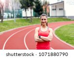 smiling sports woman standing...   Shutterstock . vector #1071880790