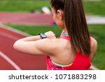 female runner looking at her...   Shutterstock . vector #1071883298