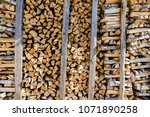 chopped firewood. large... | Shutterstock . vector #1071890258