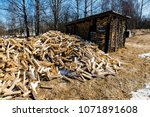 chopped firewood. large... | Shutterstock . vector #1071891608