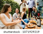 friends dining and reunion... | Shutterstock . vector #1071929219