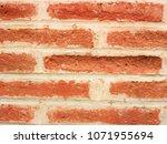 red brick wall of long... | Shutterstock . vector #1071955694