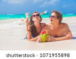 couple lyind and drinking a... | Shutterstock . vector #1071955898