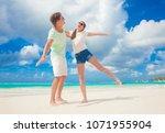 closeup of happy young... | Shutterstock . vector #1071955904