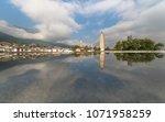 reflection of three pagodas in... | Shutterstock . vector #1071958259