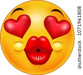 cute kissing emoticon with...
