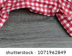 Table With Red White Checkered...