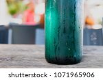 condensation on a glass bottle... | Shutterstock . vector #1071965906