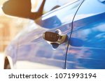 opening modern car concept with ... | Shutterstock . vector #1071993194