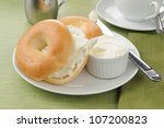 A Plate With Two Sliced Bagels...