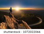 businessmen stand on high peaks ... | Shutterstock . vector #1072022066