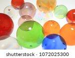 colorful glass balls | Shutterstock . vector #1072025300