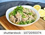hot and spicy pork rib hot pot... | Shutterstock . vector #1072050374