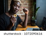 young afro american man with... | Shutterstock . vector #1072090616