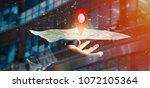 view of a businessman holding a ... | Shutterstock . vector #1072105364