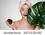 happy young girl with a towel... | Shutterstock . vector #1072120100