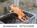 barbecued suckling pig grilled | Shutterstock . vector #1072121828