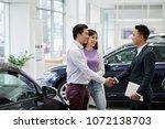 vietnamese couple buying new... | Shutterstock . vector #1072138703
