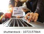 business team meeting present... | Shutterstock . vector #1072157864