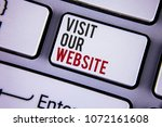 Small photo of Writing note showing Visit Our Website. Business photo showcasing Invitation Watch web page Link to Homepage Blog Internet written white keyboard key with copy space. Top view.