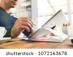 writing or signing on digital... | Shutterstock . vector #1072163678