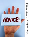 Small photo of Word writing text Advice Motivational Call. Business concept for Learn to be good at advicing people, businesses written Sticky Note Paper placed Hand the plain background.