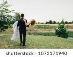 rear view of bridegroom... | Shutterstock . vector #1072171940