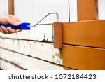 man painted wooden boards with... | Shutterstock . vector #1072184423